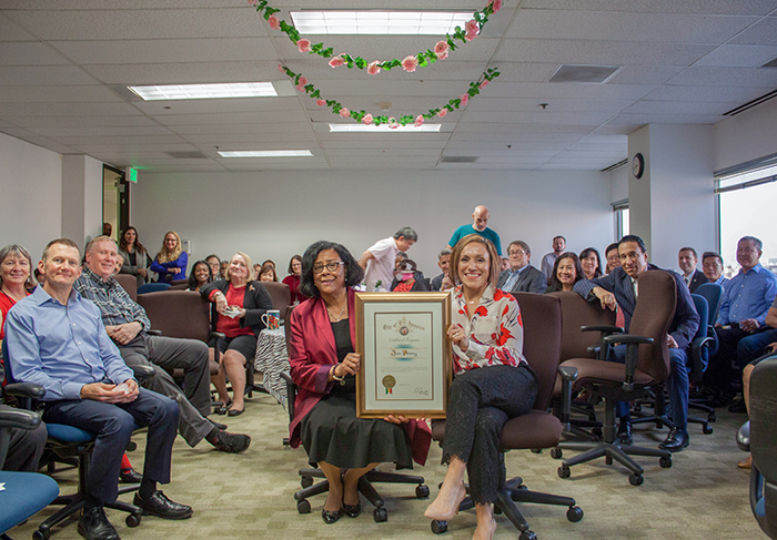 EWDD General Manager Jan Perry (center left) holds up a certificate of appreciation from Mayor Eric Garcetti presented by Chief of Staff Ana Guerrero (center right) at her going away festivities on December 18, 2018