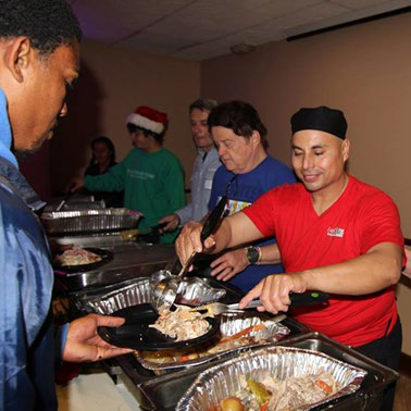 Ramon Sanchez serving food from his restaurant Mexican Grill at a holiday event
