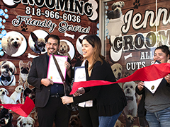 Jenny Zamora cuts the ribbon officially launching her new Panorama City business, Jenny's Dog Grooming