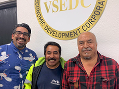 (left to right) VSEDC BusinessSource Business Coach, Juan Reyna and Luis Gutierrez pose happily after successfully applying for permits for their LA City sidewalk vending businesses